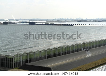 Top view of greenhouses, with lots of glass - stock photo