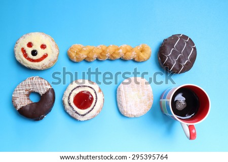 top view of group donuts isolated on blue background with copyspace - stock photo