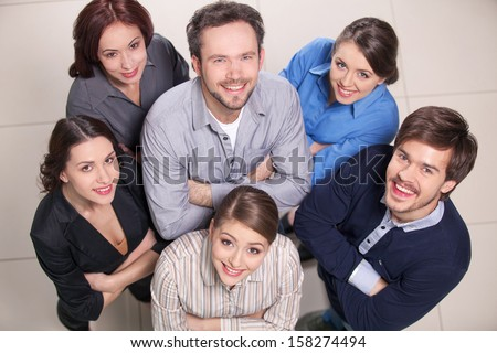 Top view of group of people. Men and women standing together  - stock photo