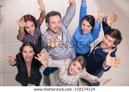 Top view of group of people. Standing together, raising their hands up - stock photo