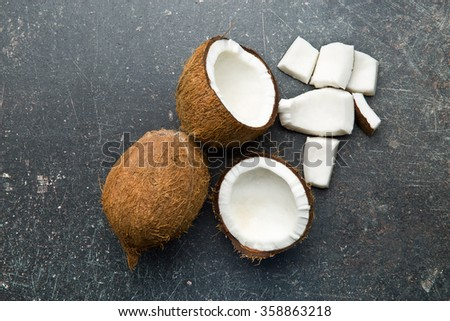 top view of halved and whole coconut - stock photo