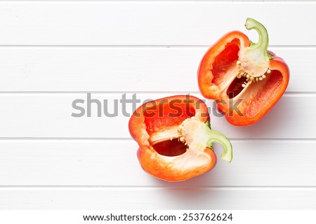 top view of halved red bell pepper on table - stock photo