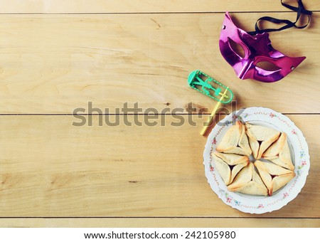 top view of Hamantaschen cookies or hamans ears and mask for Purim celebration (jewish holiday)  - stock photo