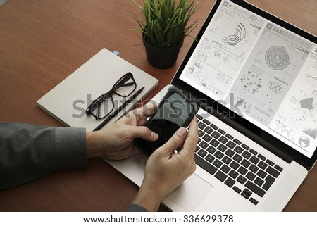 top view of hands using laptop and holding smart phone with digital business layers as Online shopping concept