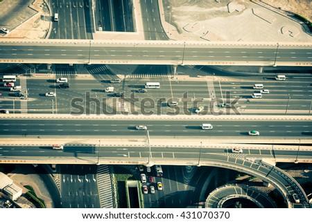 Top view of highway interchange in Dubai, UAE. Horizontal filtered shot - stock photo