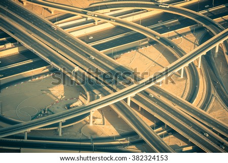 Top view of highway interchange in Dubai, UAE. Toned shot