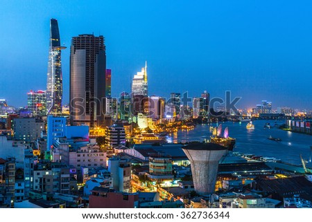 Top view of Ho Chi Minh City at night time, Vietnam. - stock photo