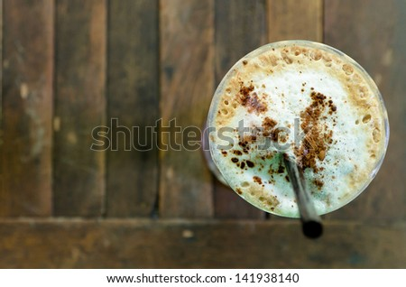 top view of Ice Coffee on the wooden table - stock photo