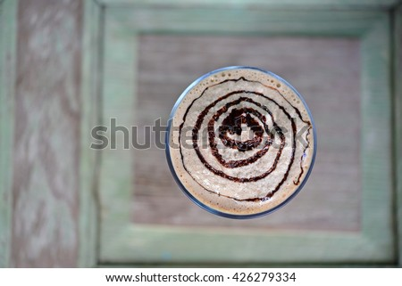 Top view of Iced chocolate on wood background - stock photo