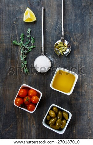 Top view of ingredients and spice for cooking on dark Wooden Background. Vegetarian food, health or cooking concept. - stock photo