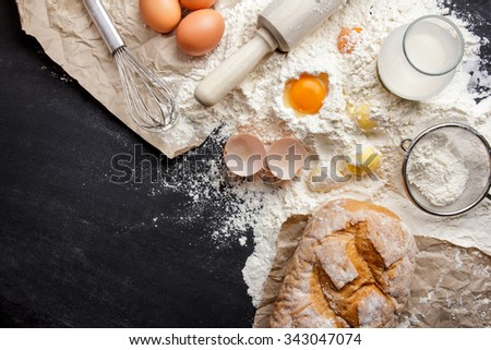 top view of ingredients of homemade bakery on black board for background with copy space - stock photo