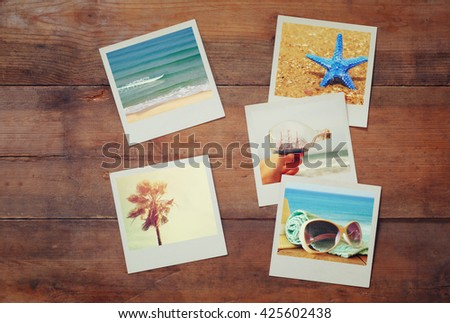 top view of instant polaroid photos album on wooden background. vintage filtered image  - stock photo