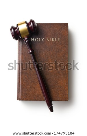 top view of judge gavel on holy bible on white background - stock photo