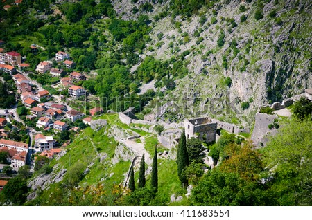top view of Kotor. Roof tops of the old town Kotor. Old church inside Stari Grad, Kotor, Montenegro. Kotor bay and Old Town from Lovcen Mountain. Montenegro. - stock photo