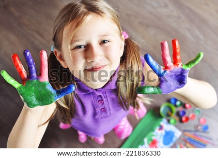 Top view of Little Girl with painted hands. Soft focus. - stock photo