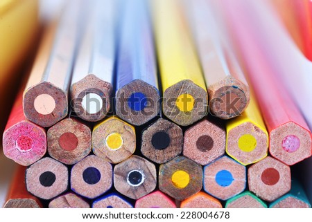 Top view of lots of multicolored pencils - stock photo