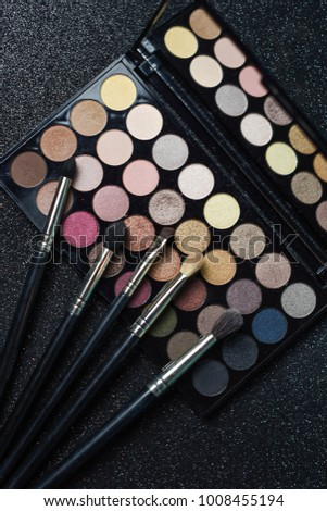 Top view of make up palettes with professional brushes