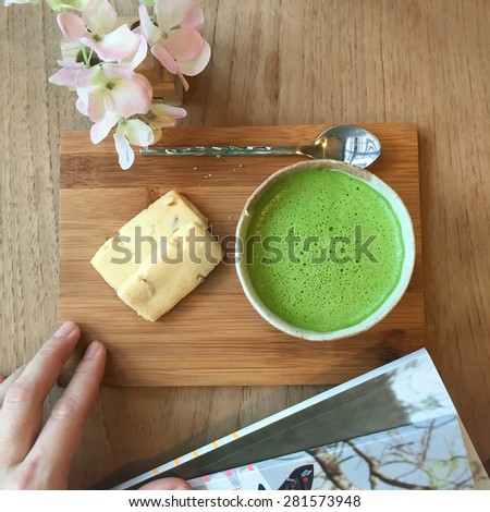 Top view of  Matcha Green Tea and cookie on wooden tray.  - stock photo
