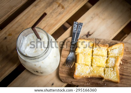 top view of milk with sweet toast on wooden table - stock photo
