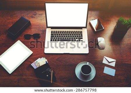 Top view of modern businessman or entrepreneur table with style accessories,euro bills,open laptop computer and digital tablet with white blank copy space screen for text information or content,filter - stock photo