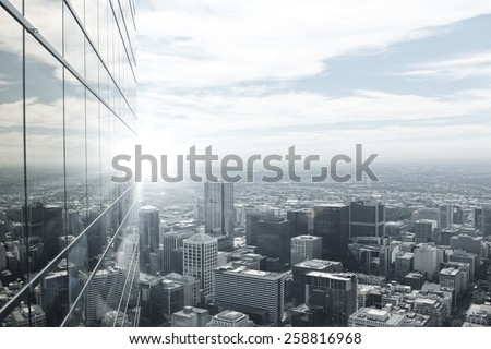 Top view of modern city in lights of sunset - stock photo
