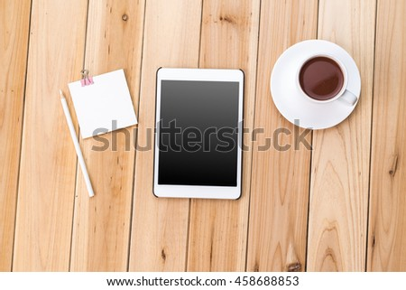 Top View of Modern Technology working Place on wooden Office Desk