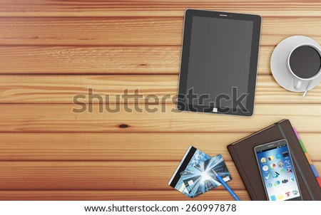 Top View of Modern Workplace with Group of Office Equipment and Accessories: Tablet PC, Smart Phone, Credit Cards, Notebook and Cup of Coffee on wooden background - stock photo