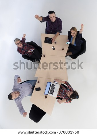 top view of multi ethnic startup business people group on brainstorming meeting in modern bright office interior