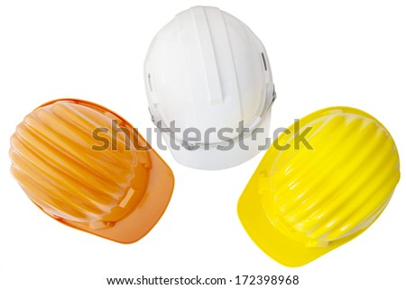 top view of multicolor safety, construction protection helmet  isolated white background - stock photo
