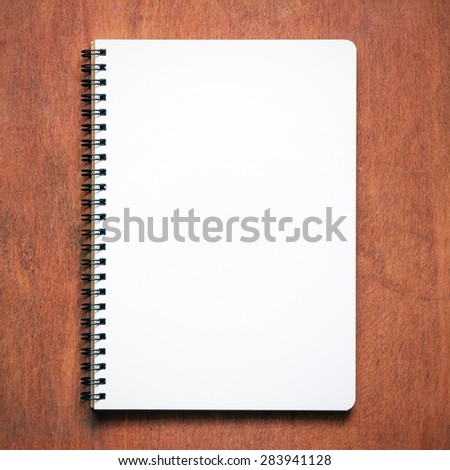 Top view of note book on wooden table