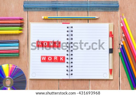 Top view of open exercise book,pencil crayons on a wooden table,Selective focus,copy space background,education concept.