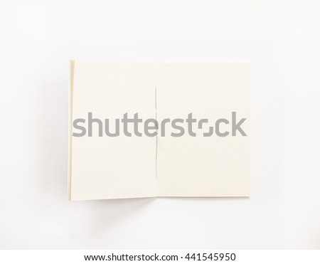 Top view of opened  notebook on white  background. - stock photo