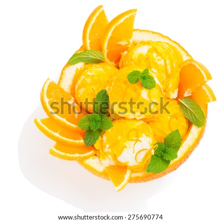 Top view of orange ice cream decorated with leaves of mint in a rind of orange fruit isolated on white background - stock photo