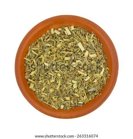 Top view of organic wormwood in a small bowl on a white background. - stock photo