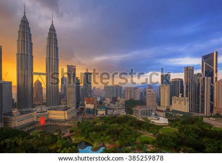 Top view of Park and Kuala Lumper city skyline at twilight in Malaysia - stock photo