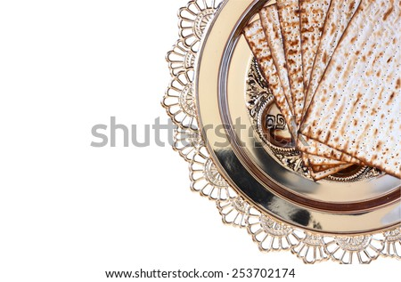 top view of passover background. matzoh (jewish holiday bread) and traditional sedder plate. isolated on white - stock photo