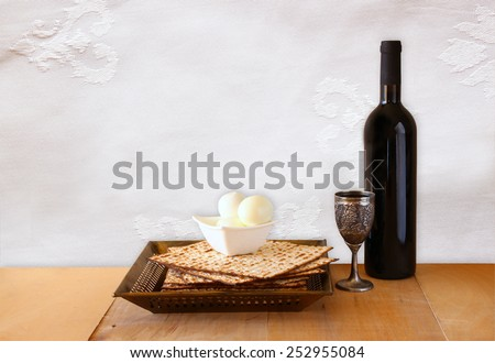 top view of passover background. matzoh (jewish passover bread) and traditional sedder plate over wooden background - stock photo