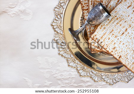 top view of passover background. matzoh (jewish passover bread) and traditional sedder plate over wooden table - stock photo
