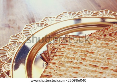 top view of passover background. matzoh (jewish passover bread) over wooden background.  - stock photo