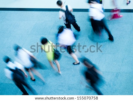 Top view of people crowd in motion at the modern building. - stock photo
