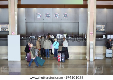 Top view of people stand near registration counter in modern hotel - stock photo