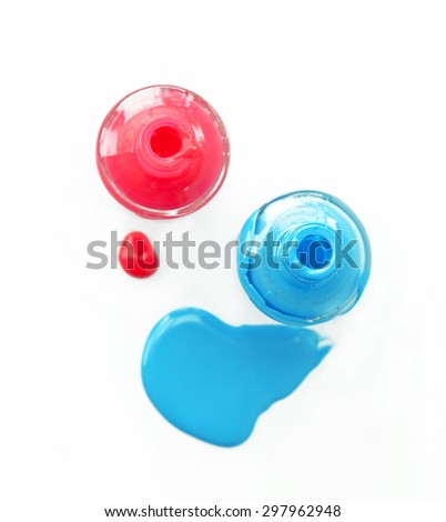 Top view of pink and blue matte nail polish on white background. - stock photo