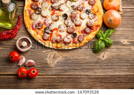 Top view of pizza with ingredients - stock photo