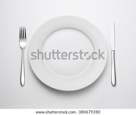 Top view of place setting with plate, knife and fork, with clipping path - stock photo