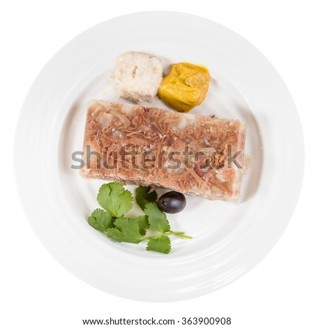 top view of portion of meat aspic on white plate isolated on white background - stock photo