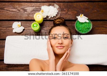 Top view of pretty young woman laying in spa salon relaxing - stock photo