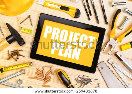 Top View of Project Plan For Home Redecoration Work with Digital Tablet and Assorted Woodwork and Carpentry Tools on Workshop Table - stock photo