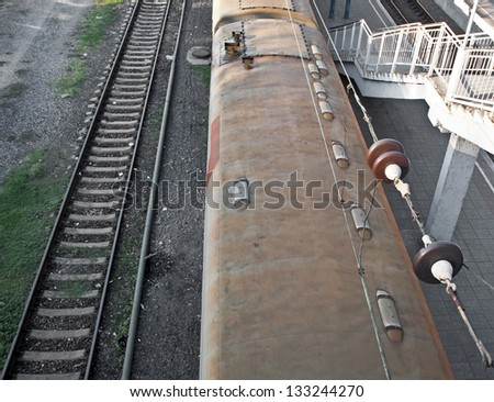 Top view of railway track and passenger train - stock photo