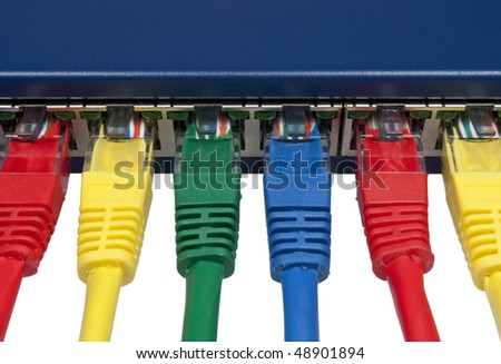 Top view of rainbow colored ethernet network cables connected to a router /switch isolated on white background