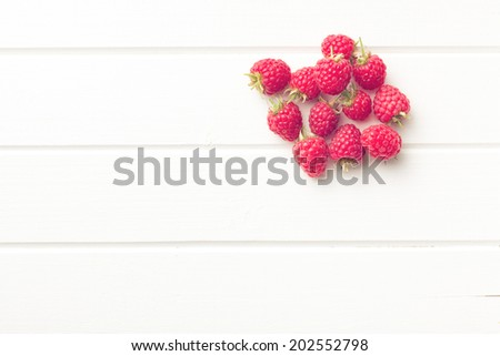 top view of raspberries on white table - stock photo